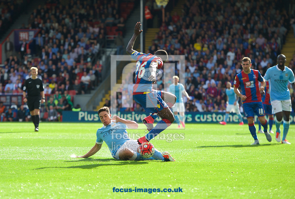 Samir Nasri of Manchester City slides in on Pape Souare of Crystal Palace during the Barclays Premier League match at Selhurst Park, London<br /> Picture by Alan Stanford/Focus Images Ltd +44 7915 056117<br /> 12/09/2015