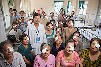 Opthlamologist Luong Huu Thien with all his patients over one day of surgery Vinh Long Centre of Social Diseases Prevention.