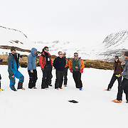 Jökull Bergmann, ski guide, giving the group a little lecture about avalanches and avalanche danger.<br /> <br /> Images from an ski touring adventure to Jökulfirðir, a series of fjords in west Iceland, with Bergmenn Mountain Guides and Borea Adventures. The tour takes skiers from fjord to fjord with the sail boat Aurora as a overnight base.