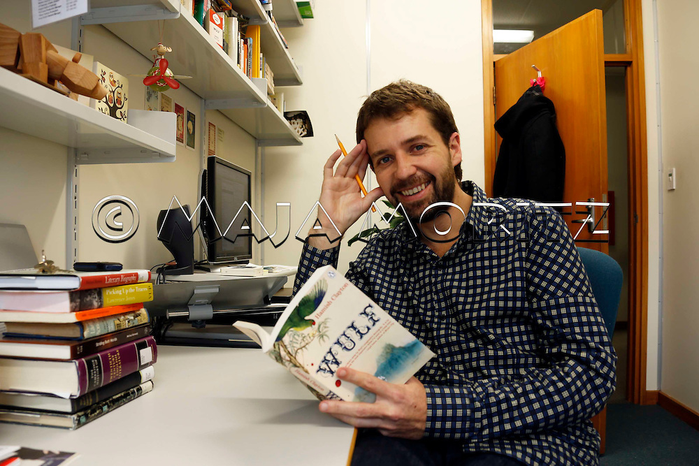 """Hamish Clayton in his office at Victoria University of Wellington, New Zealand, with his first novel """"Wulf"""""""