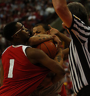 MORNING JOURNAL/DAVID RICHARD.Marcus Landry, left, of Wisconsin ties up Ohio State's Jamar Butler Sunday, Feb. 25, 2007, in Columbus, Ohio.The Buckeyes called a timeout to keep possession and Ohio State beat Wisconsin 49-48.