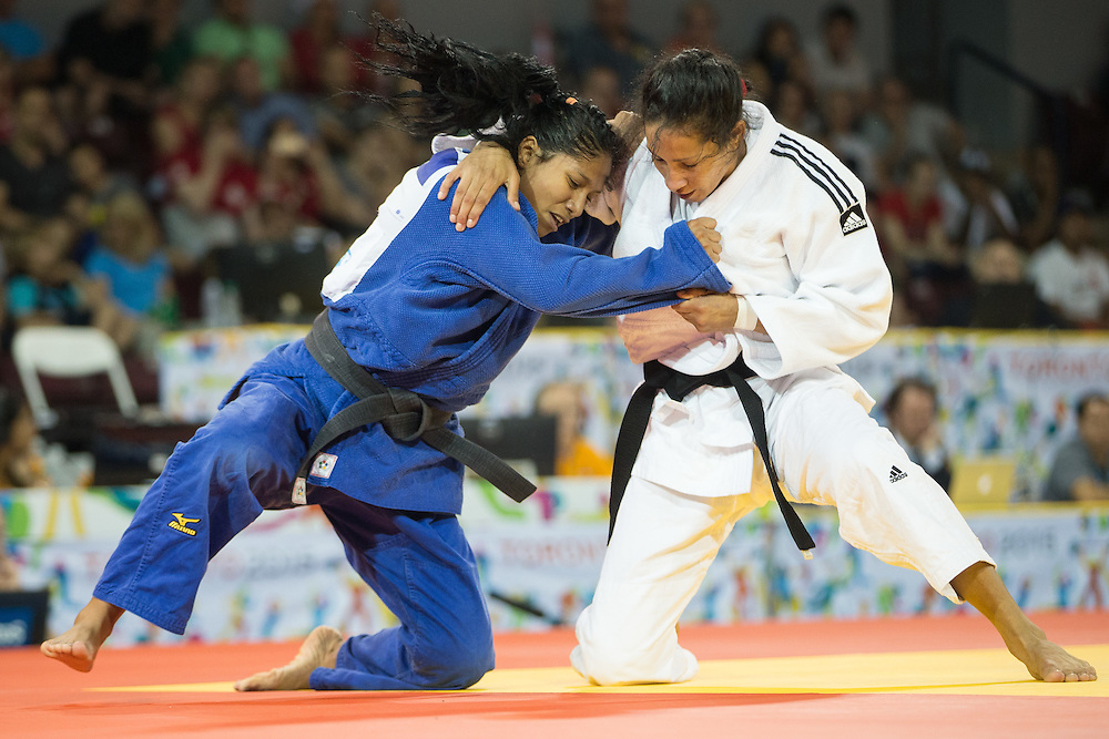 Joselin Plaza of Ecuador (L) and Aliuska Ojeda of Cuba  vie for position in the bronze medal contest in the women's judo 57kg class at the 2015 Pan American Games in Toronto, Canada, July 12,  2015.   AFP PHOTO/GEOFF ROBINS