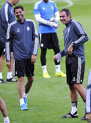 Real Madrid Assistant Coach, Paul Clement and Real Madrid Assistant Coach, Fernando Hierro share a joke before training  - Photo mandatory by-line: Joe Meredith/JMP - Mobile: 07966 386802 11/08/2014 - SPORT - FOOTBALL - Cardiff - Cardiff City Stadium - Real Madrid v Sevilla - UEFA Super Cup - Press Conference and Open Training session