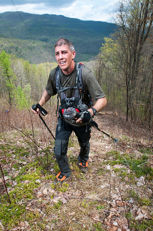 Aaron Sorenson, 39, San Francisco, CA climbs the testical spectacle on loop 1 of the Barkley Marathons.