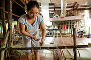 A woman prepares her loom to make jute mats on Binh Thanh Island, Vietnam.