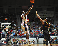 "Ole Miss' Nick Williams (20) shoots over Missouri's Phil Pressey (1) at the C.M. ""Tad"" Smith Coliseum on Saturday, January 12, 2013. Ole Miss defeated #10 ranked Missouri 64-49."