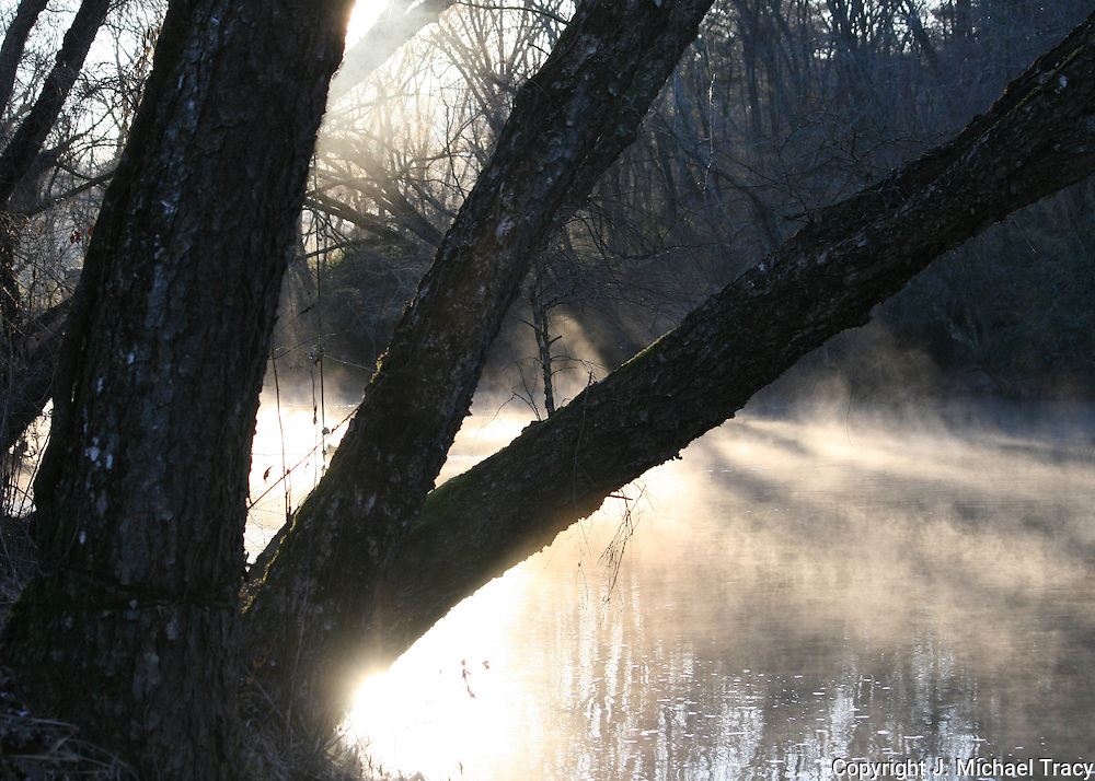 Sunrise on the Toccoa River, Blue Ridge Georgia, mid winter with mist rising.