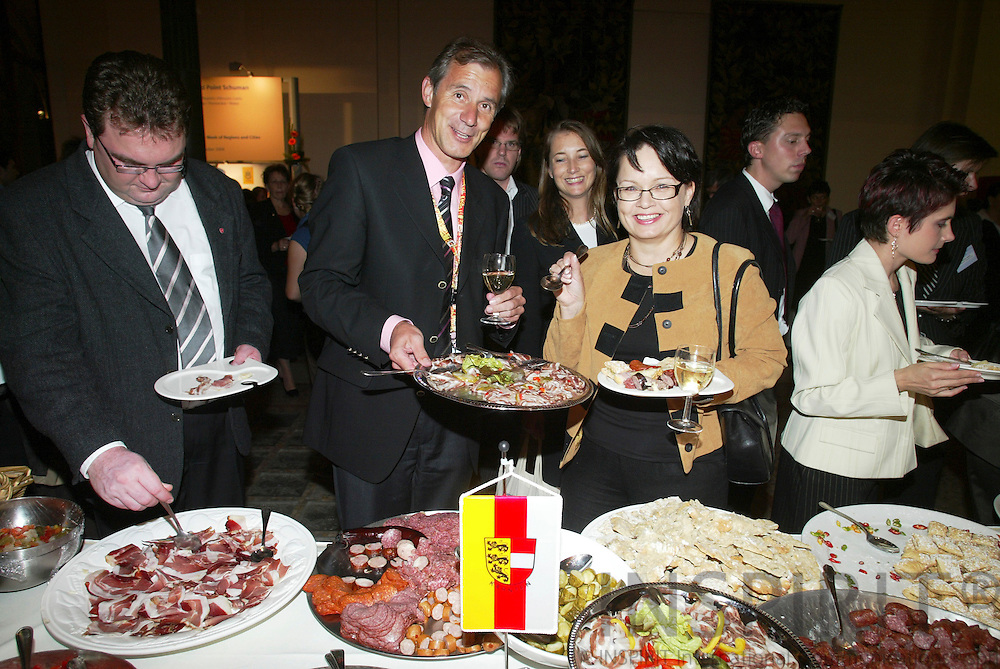 BRUSSELS - BELGIUM - 11 OCTOBER 2006 -- Minister Josef MARTINZ, Austrian Region of Carinthia, offering his homeregions specialities to guest at the official reception at the Royal Museums for Art and History in connection with Committee of Regions Open Days. -- PHOTO: ERIK LUNTANG /