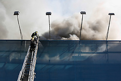 June 20, 2017 - Kiev, Ukraine - Three-storey historical building downtown Kyiv is set aflame. A large number of fire engines and firefighters are involved in the elimination of large-scale fire, Kyiv, Ukraine, June 20, 2017. (Credit Image: © Sergii Kharchenko/NurPhoto via ZUMA Press)