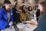 From left: Yu Zhang, Chi Zhang, Xiuying Wang, and Yanhui Liu speak with Vinton County High School students at a table containing educational materials about China during the Diversity Fair held in the school gym on March 21, 2014. Photo by Lauren Pond