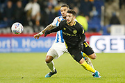 Danny Simpson of Huddersfield Town and Saïd Benrahma of Brentford contest a loose ball  during the EFL Sky Bet Championship match between Huddersfield Town and Brentford at the John Smiths Stadium, Huddersfield, England on 18 January 2020.