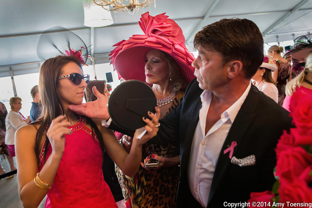 SARATOGA SPRINGS, NEW YORK - AUGUST 15, 2014: Michele Riggi (middle), her niece and assistant Macie Fusco (right) attend the Sizzling Hot Pink Saratoga Hat Luncheon to benefit the Breast Cancer Research Foundation. Photo by Amy Toensing _________________________________<br />