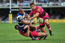 Jonathan Joseph of Bath Rugby offloads the ball after being tackled - Photo mandatory by-line: Patrick Khachfe/JMP - Mobile: 07966 386802 13/09/2014 - SPORT - RUGBY UNION - Bath - The Recreation Ground - Bath Rugby v London Welsh - Aviva Premiership