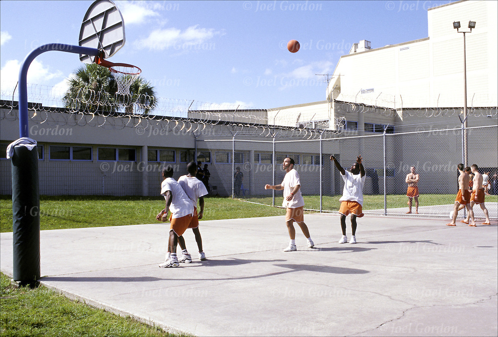 Playing basketball in exercise yard - Detention Facility (Jail) housing Inmates from Min. to Capitol Life Felons  Phoenix Facility - Orange County Jail, FL  Dwayne McClenan, Jeffery  Collins, Roy Manning, Noe Nortega  detainees