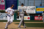 Jonathan Van Avery of the Pawtucket Red Sox rounds third base in an April game with the Syracuse Chiefs as #21 Sergio Santos looks away.