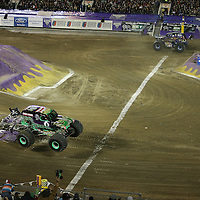 Son-uva Digger driver Ryan Anderson in the far lane, beats Grave Digger driven by Dennis Anderson to win the Monster Jam big truck event at the Citrus Bowl in Orlando, Florida on Saturday, January 25, 2014. (AP Photo/Alex Menendez)
