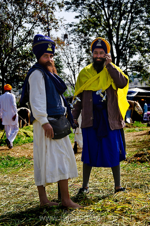 The Nihangs, who can perhaps claim to be the most photographed persons in this part of the world, sport their newly stitched choga (traditional robes) and shashtar (weapons).