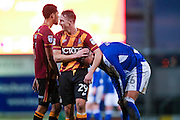 Bradford City defender Anthony McMahon (29)  shares a joke with Chesterfield defender Ian Evatt (6)  during the EFL Sky Bet League 1 match between Bradford City and Chesterfield at the Northern Commercials Stadium at Valley Parade, Bradford, England on 7 January 2017. Photo by Simon Davies.