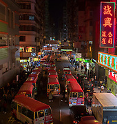 Red busses in Mong Kok Street, Hong Kong, China.