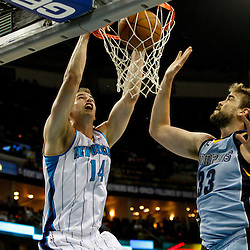 April 15, 2012; New Orleans, LA, USA; New Orleans Hornets power forward Jason Smith (14) dunks over Memphis Grizzlies center Marc Gasol (33) during the first quarter of a game at the New Orleans Arena.   Mandatory Credit: Derick E. Hingle-US PRESSWIRE