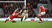 South Africa's Handre Pollard palming off his opposite number during the Rugby World Cup Quarter Final match between South Africa and Wales at Twickenham, Richmond, United Kingdom on 17 October 2015. Photo by Matthew Redman.