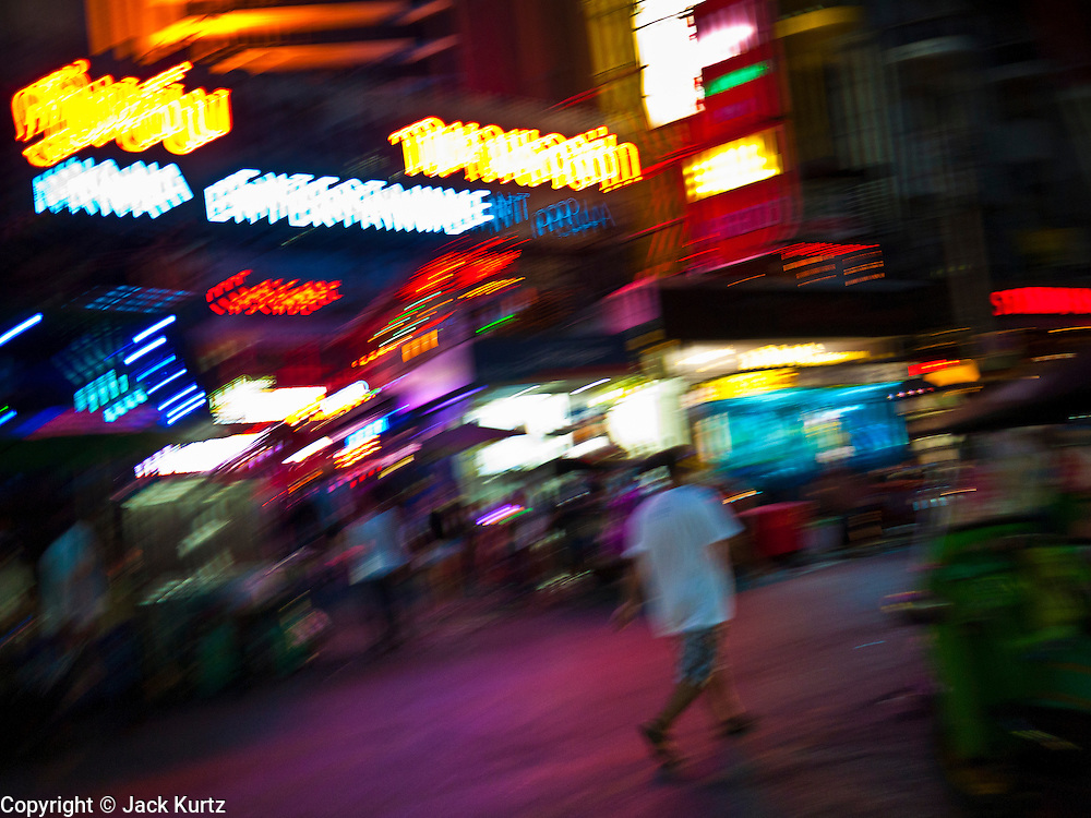 "13 JULY 2011 - BANGKOK, THAILAND:  Entrance to the Nana Entertainment Plaza, a ""red light"" district in Bangkok. Prostitution in Thailand is illegal, although in practice it is tolerated and partly regulated. Prostitution is practiced openly throughout the country. The number of prostitutes is difficult to determine, estimates vary widely. Since the Vietnam War, Thailand has gained international notoriety among travelers from many countries as a sex tourism destination. One estimate published in 2003 placed the trade at US$ 4.3 billion per year or about three percent of the Thai economy. It has been suggested that at least 10% of tourist dollars may be spent on the sex trade. According to a 2001 report by the World Health Organisation: ""There are between 150,000 and 200,000 sex workers (in Thailand).""  PHOTO BY JACK KURTZ"