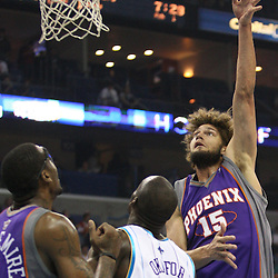 Feb 01, 2010; New Orleans, LA, USA; Phoenix Suns center Robin Lopez (15) shoots over New Orleans Hornets center Emeka Okafor (50) during the first half at the New Orleans Arena. Mandatory Credit: Derick E. Hingle-US PRESSWIRE