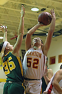 Marion's Michalyn Mohr (52) puts up a shot over Beckman's Andrea Keegan (35) during their game at Marion High School, 675 South 15th Street, in Marion, on Tuesday evening, November 22, 2011. (Stephen Mally/Freelance)