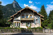 Painted facade of Grimms Fairy Tale story of Little Red Riding Hood in the village of Oberammergau in Bavaria, Germany