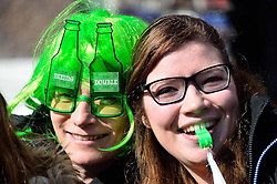 Two women watch the parade as it travels along Piccadilly to celebrate St. Patrick's Day in London, Britain, on March 13, 2016. EXPA Pictures © 2016, PhotoCredit: EXPA/ Photoshot/ Ray Tang<br /> <br /> *****ATTENTION - for AUT, SLO, CRO, SRB, BIH, MAZ, SUI only*****