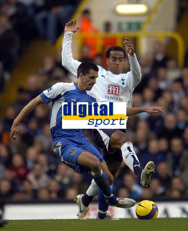 Photo: Olly Greenwood.<br />Tottenham Hotspur v Wigan Athletic. The Barclays Premiership. 26/11/2006. Tottenham's Tom Huddlestone tackles Wigan's Paul Scharner