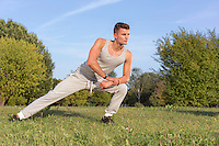 Full length of confident man exercising in park