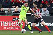 Exeter City midfielder Jake Taylor (25) and Lincoln City midfielder Elliott Whitehouse (4) battles for possession  during the EFL Sky Bet League 2 match between Lincoln City and Exeter City at Sincil Bank, Lincoln, United Kingdom on 30 March 2018. Picture by Mick Atkins.