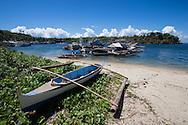 """Tambobo Bay is located at the southern tip of Negros Island. Long popular with yachties who anchor in the safe bay.  As a bonus  there are a few patches of white sand beach.  It is said that some buried treasure is hidden here, too which only enhances the """"pirate cove"""" effect of the place."""