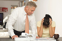 Tax Accountant Giving Woman Bad News
