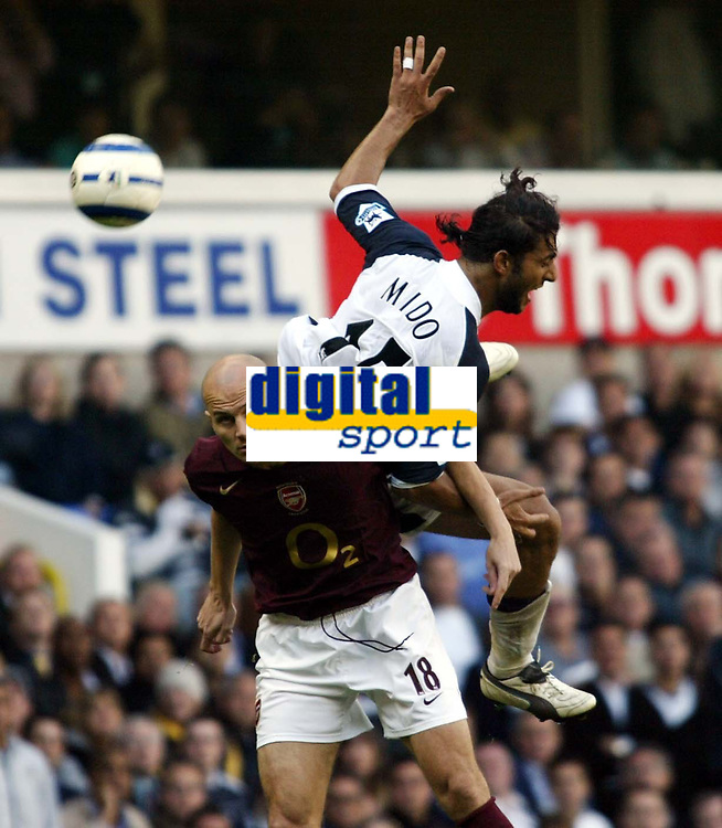 Photo: Chris Ratcliffe.<br />Tottenham Hotspur v Arsenal. The Barclays Premiership.<br />29/10/2005.<br />Mido of Spurs goes up with Pascal Cygan of Arsenal