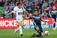Central Coast Mariners midfielder Tommy Oar (10) comptes with Melbourne Victory midfielder Carl Valeri (21) at the Hyundai A-League Round 4 soccer match between Melbourne Victory and Central Coast Mariners at AAMI Park in Melbourne.