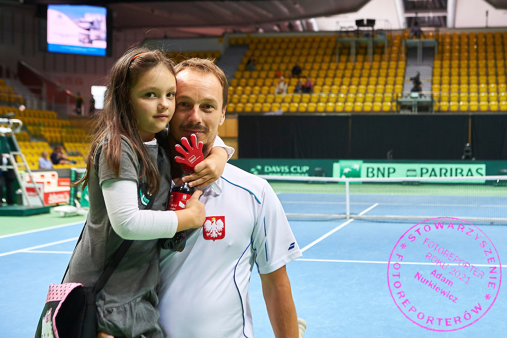 Radoslaw Szymanik - captain national team and his daughter during Davis Cup Tie World Group Play-off Poland v Slovakia at Gdynia Arena Hall in Gdynia, Poland.<br /> <br /> Poland, Gdynia, September 18, 2015<br /> <br /> Picture also available in RAW (NEF) or TIFF format on special request.<br /> <br /> For editorial use only. Any commercial or promotional use requires permission.<br /> <br /> Adam Nurkiewicz declares that he has no rights to the image of people at the photographs of his authorship.<br /> <br /> Mandatory credit:<br /> Photo by &copy; Adam Nurkiewicz / Mediasport