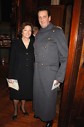 MAJOR GENERAL SIR SEBASTIAN ROBERTS & LADY ROBERTS at a carol service in aid of the Friends of Ampleforth Lourdes Sick held at Our Most Holy Redeemer and St.Thomas More Church, Cheyne Row, London SW3 on 6th December 2007.<br />