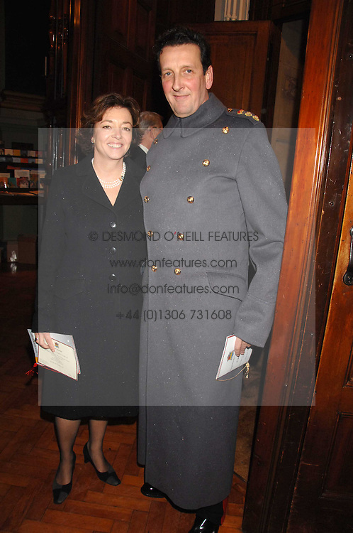 MAJOR GENERAL SIR SEBASTIAN ROBERTS &amp; LADY ROBERTS at a carol service in aid of the Friends of Ampleforth Lourdes Sick held at Our Most Holy Redeemer and St.Thomas More Church, Cheyne Row, London SW3 on 6th December 2007.<br />