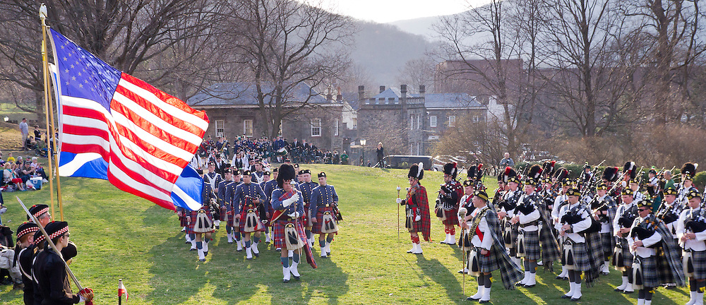 West Point, New York - Pipe and drum bands march on for the mass performance at the 32nd annual West Point Military Tattoo at Trophy Point at the United States Military Academy  on April 13, 2014.