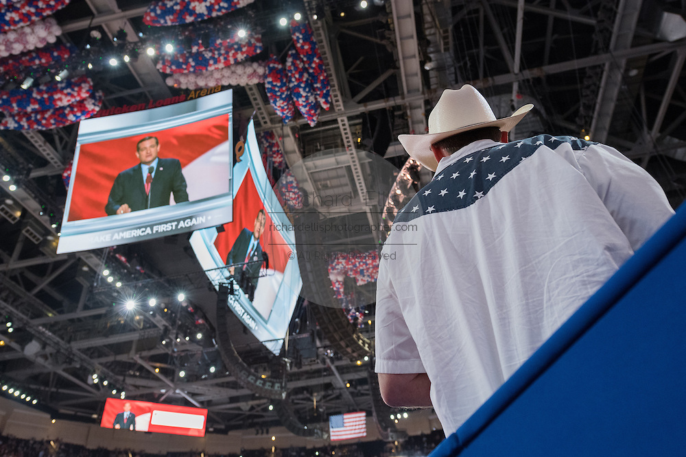GOP delegates watch Senator Ted Cruz during his address during the third day of the Republican National Convention July 20, 2016 in Cleveland, Ohio. Cruz spoke without endorsing Republican Presidential candidate Donald Trump and told delegates to vote with the conscience.