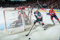 KELOWNA, CANADA - FEBRUARY 17: Riley McKay #27 of the Spokane Chiefs back checks Calvin Thurkauf #27 of the Kelowna Rockets during third period as he skates behind the net with the puck on February 17, 2017 at Prospera Place in Kelowna, British Columbia, Canada.  (Photo by Marissa Baecker/Shoot the Breeze)  *** Local Caption ***