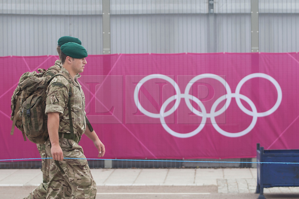 © licensed to London News Pictures. London, UK 14/07/2012. Soldiers walking outside the Olympic site in Stratford today. Photo credit: Tolga Akmen/LNP