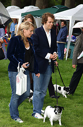 LAURA and TOM PARKER-BOWLES at the 3rd annual Macmillan Dog Day in aid of Macmillan Cancer Relief held at Royal Hospital Chelsea, London SW3 on 5th July 2005.<br />