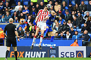 Stoke City striker Peter Crouch (25) and Leicester City defender Yohan Benalouane (29) battle in the air during the Premier League match between Leicester City and Stoke City at the King Power Stadium, Leicester, England on 1 April 2017. Photo by Jon Hobley.
