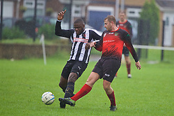 CARDIFF, WALES - Saturday, September 3, 2016: Action from the FAW Trophy 2nd Round match between Grange Albion FC [black and white stripes] and Carnetown FC [red] at Coronation Park. (Pic by David Rawcliffe/Propaganda)