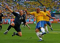 Photo: Glyn Thomas.<br />Brazil v Australia. Group F, FIFA World Cup 2006. 18/06/2006.<br /> Brazil's Ronaldo (R) shoots under pressure from Australia's Craig Moore.