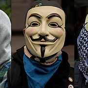 Close up of three masked &quot;Anonymous&quot; protesters at the &quot;Occupy Wall Street&quot; a protest, rally on September 17, 2011.<br /> <br /> Anonymous is a group initiating active civil disobedience and spread through the Internet while staying hidden, representing the concept of many online community users simultaneously existing as an anarchic, digitized global brain. <br /> <br /> It is also generally considered to be a blanket term for members of certain Internet subcultures, a way to refer to the actions of people in an environment where their actual identities are not known.<br /> <br /> Anonymous - GOR-83818-11<br /> Anonymous - GOR-83802-11<br /> Anonymous - GOR-83811-11