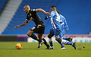 Bolton Wanderers midfielder, Darren Pratley (21) gets away from Brighton midfielder, winger, Kazenga LuaLua (30) during the Sky Bet Championship match between Brighton and Hove Albion and Bolton Wanderers at the American Express Community Stadium, Brighton and Hove, England on 13 February 2016.